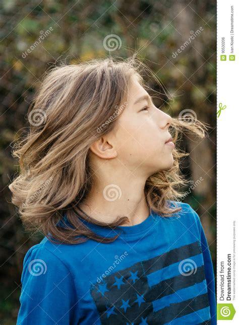 Boy long hair stock photos royalty free boy long hair images jpg 955x1300